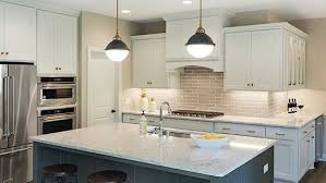 brass light fixtures in gonyea home above center kitchen island