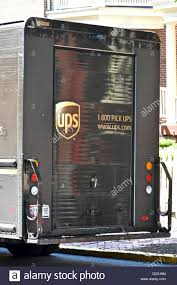100 Who Makes Ups Trucks A UPS Truck Parked On The Street While The Driver Makes A Delivery