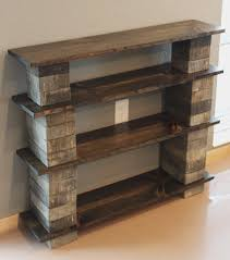 Three Tiered Of DIY Concrete Block Bookshelf With Old Reclaimed Wood Racks On Cream Glossy Floor At Soft Grey Wall Theme