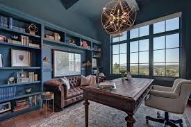 colorful blue built in bookcase frames gorgeous leather
