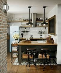 Industrial Rustic Kitchen With Brick Wall Iron Hanging Pendant Lights Dark Cabinets Butcher