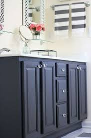 navy blue cabinet megan s vanity via thrifty decor chick