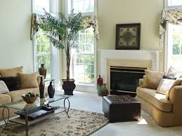 pale yellow wall color with amazing fireplace and glass coffee