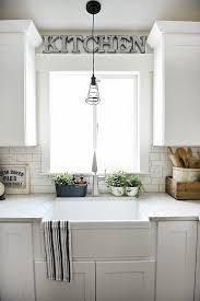 light above kitchen sink interior design ideas