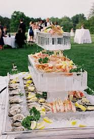 Wedding Food Station Idea Ice Sculpture Raw Bar Featuring Tiers Of Fresh Crab Legs And Oysters