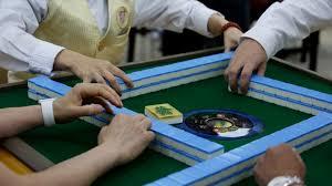 Familiar Hong Kong sound of mahjong tiles may be fading as more