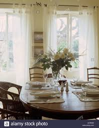 Vase Of White Roses On Table Set For Lunch With White Plates ... 100 French Country Ding Room Fniture Old Amazoncom Baxton Studio Laurence Cottage 5 Country Ding Room Beamed Ceiling Stable Door Table In Layjao Pair Ethan Allen Ladder Back Arm Charming Decor Ideas For Your Home Chairs White Set Wwwxandfiddlecaliforniacom Vase Of White Roses On Set Lunch With Plates 19 Examples Dcor Fniture Decoration Designs Guide Style Tables Sydney Parquetry Elm Timber