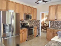 light brown kitchen cabinets sandstone rope door kitchen