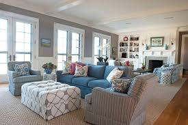 Interior Interesting Coastal Living Room Design Ideas Added Blue Sectional Sofa And Tufted Ottoman Plus Grey Armchair Also Under Mount Wall Shelves