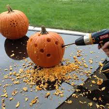 Drilled Jack O Lantern Patterns by Diy Pumpkin Carving With A Drill The Garden Glove