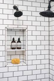 shower with white subway tiles and black grout transitional