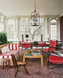 Retro Living Area Sunroom Decorating Idea With Unique Rattan Couch And Chair Antique Wood Coffee Table Black Red Lounge Chairs Also Bird Cage