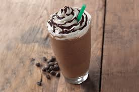 Coffee With Rich Mocha Flavored Sauce Blended Milk Chocolaty Chips And Ice Topped Sweetened Whipped Cream Chocolate Drizzle