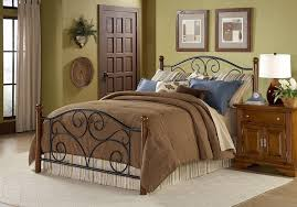 Brown And Blue Bedding by Black Metal Bed Frame With Curving Head And Foot Board Combined