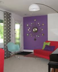 interesting decorating with lavender color walls with red sofa