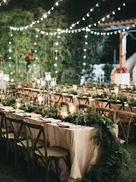 Strung Above Outdoor Reception Tables Creative String Light Ideas For A Romantic Wedding