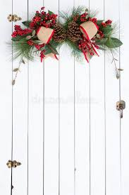 Download White Barn Door With Rustic Christmas Decoration Stock Photo