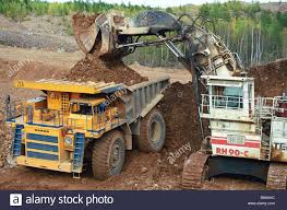 Loading Gold Ore Into Large Dump Trucks At The Bokovoye Gold Field ... Buy Large Dump Trucks And Get Free Shipping On Aliexpresscom Caterpillar Cat 794 Ac Ming Truck In Articulated Pit Mine Large Dump Stock Photo 514340608 Shutterstock Truck Driving Up A Mountain Dirt Road West The Worlds Biggest Top Gear Dumping Copper Ore Into Giant Crusher Tri Axle Trucks For Sale Tags 31 Incredible 5 The World Red Bull Belaz 75710 Claims Largest Title Trend Biggest Dumptruck 797f Youtube Pin By Scott Lapachinsky Ford Big Rigs Pinterest