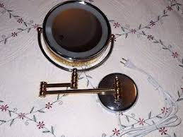 2 sided swivel halo lighted wall mount mirror 5x 1x magnification