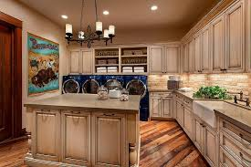 Country Style Laundry Room With Two Sets Of Washers And Dryers