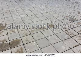 patterned paving tiles cement brick floor background Stock