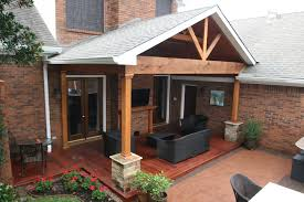 tongue and groove wood roof decking hardwood deck and gable roof patio cover with ledgestone half