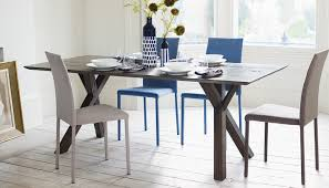 Arbori Table Complemented By Tego Chairs In Blue And Sand Mervyn Gers Tableware