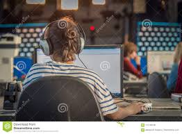 Download A Journalist Working On Computer In Newsroom Editorial Stock Photo