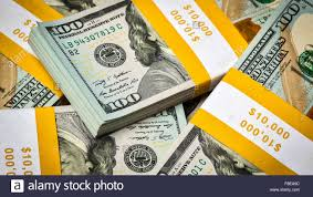 Background of new 100 US dollars banknotes bills Stock