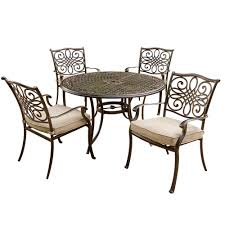 Hanover Traditions 5-Piece Patio Outdoor Dining Set With 4-Cast Aluminum  Dining Chairs And 48 In. Round Table Hampton Bay Statesville 5piece Padded Sling Patio Ding Set With 53 In Glass Top Garden Fniture Wikipedia 6 Seater Outdoor Fniture Table And Chairs Cushion Sets Mandaue Foam Great Round Remodel Torino 7 Piece A Guide To Chair Height Branch Outdoor Table Metal From Trib 4 Bistro Steel Heart Cream Devoko 9 Pieces Space Saving Rattan Cushioned Seating Back Sectional