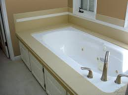 Tiling A Bathtub Deck by Tub Deck U0026 Custom Slab Prices Hourglass Kitchen U0026 Bath Products