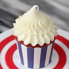 A Close Up Photo Of Cupcakes Topped With Beautiful Piped Dollop Cream Cheese