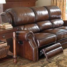 The Leather Newbury Motion Sofa by Bassett Furniture features winged adjustable pub backs