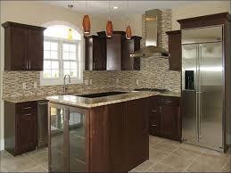 fresh santa cecilia light granite with cabinets kitchen