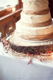 A Tree Slice Serves As Cake Stand And Is Surrounded With Holly Berries Raffia Autumn Wedding CakesRustic