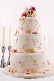 A pretty wedding cake with extra deep tiers Each tier decorated