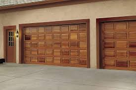 exterior modern wood tile panel garage door design with light
