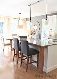 Open Layout Kitchen And Dining Room Gray Quartz Rustic Wood Island Supports Benjamin Moore On Walls Cloud White Maple Cabinets