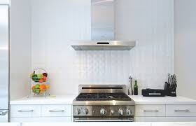 white ceramic tile backsplash in the kitchen adds depth to setting