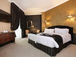 photo chambre le confort d un hôtel de prestige quatre étoiles à nîmes