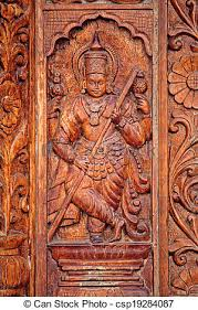 pictures of wooden carving at shri damodar temple zambaulim goa