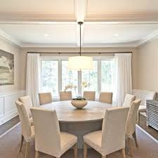Example Of A Classic Dark Wood Floor And Brown Dining Room Design In New York