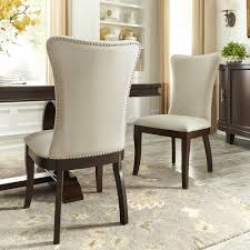 Shop Willa Beige Fabric Wingback Dining Chairs With Nailhead Trim ... Wingback Ding Chair White And Gray Roundhill Button Tufted Solid Wood Hostess Chairs With Amazoncom Lazymoon Beige Pattern New Pacific Direct Inc Aaron Upholstered Parson Nailhead Trim With Msp Design Show How To Recover A Richmond Vintage Tan Leather Zin Home Nail Head Accent Ramalanco Homespot Archie Pu Velvet Set Of 2