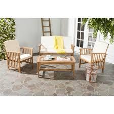 Safavieh Rocklin 4 Piece Patio Seating Set with Beige Cushions