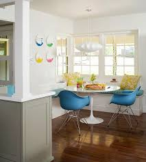 A Modern Table And Chairs Set Pendant Lighting Wall Decor Put Stylish Spin On Traditional Breakfast Nook Keeping The Walls White In Both This