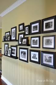 Create A Bold Look By Pairing Large Black Frames With Bright White Photos You Can Also Use Matching Shelves To Display Some Of The