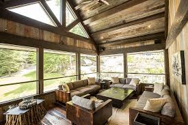 Sunroom Ideas With Rustic Design Styles Also Square Coffee Table And Unique Legs Tables Wood Wall Panel Large Glass Window Seating Couch