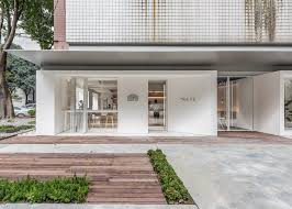 Smooth Surfaces Such As White Walls And Terrazzo Flooring Dominate The Main Space Serving A Canvas To Capture Light