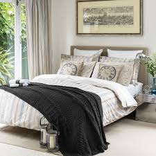 Grey King Size Bed With White Bedding White Gold Pillows And Duvet