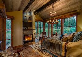 View In Gallery Woodsy Cabin Style Bedroom With A Fireplace